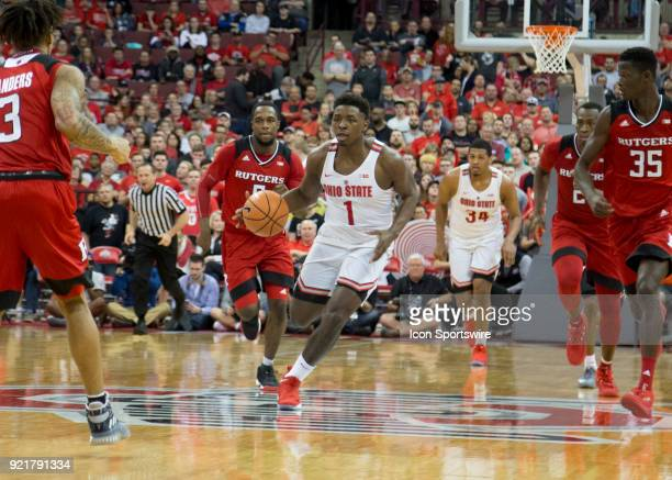 Jae'Sean Tate of the Ohio State Buckeyes dribbles the ball down the court during the game between the Ohio State Buckeyes and the Rutgers Scarlet...