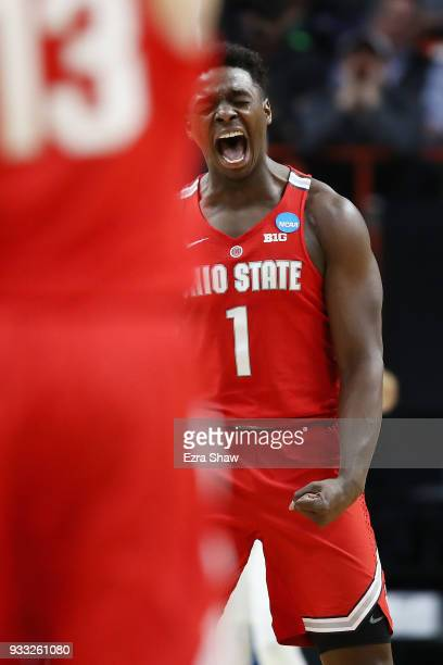 Jae'Sean Tate of the Ohio State Buckeyes reacts after dunking the ball during the second half against the Gonzaga Bulldogs in the second round of the...