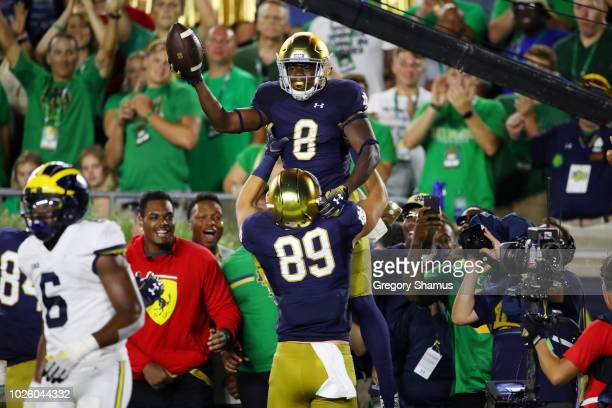 Jafar Armstrong of the Notre Dame Fighting Irish celebrates a second quarter touchdown against the Michigan Wolverines at Notre Dame Stadium on...