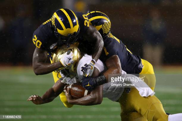 Jafar Armstrong of the Notre Dame Fighting Irish is tackled during a first half run by Brad Hawkins and Ambry Thomas of the Michigan Wolverines at...