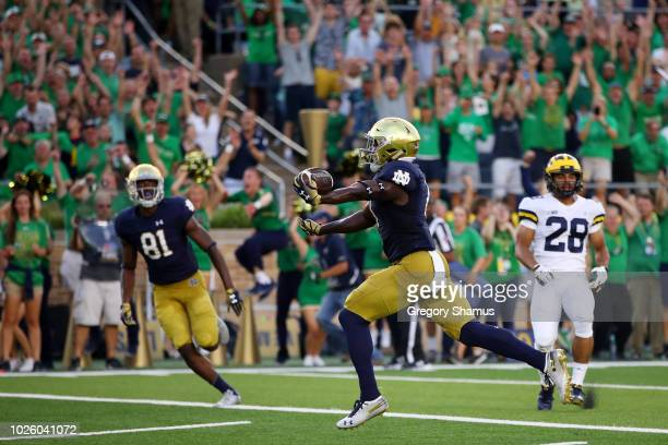 Jafar Armstrong of the Notre Dame Fighting Irish scores a first quarter touchdown against the Michigan Wolverines at Notre Dame Stadium on September...