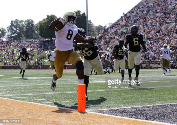 Jafar Armstrong of the Notre Dame Fighting Irish scores a touchdown against the Wake Forest Demon Deacons during their game at BBT Field on September...