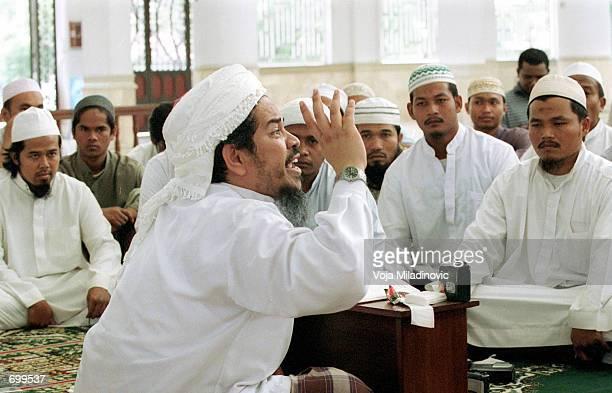 Jafar Umar Thalib Afghan war veteran and commander of Indonesias militant Laskar Jihad preaches at a mosque February 18 2002 in Aceh Indonesia Thalib...