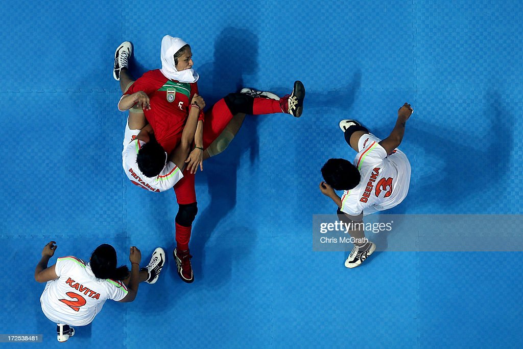 Jafarikalokan Sedigheh #5 of Iran is caught by Priyanka Priyanka #6 of Independent Olympic Athletes during the Women's Kabaddi Gold Medal match at Ansan Sangnoksu Gym on day five of the 4th Asian Indoor & Martial Arts Games on July 3, 2013 in Incheon, South Korea.