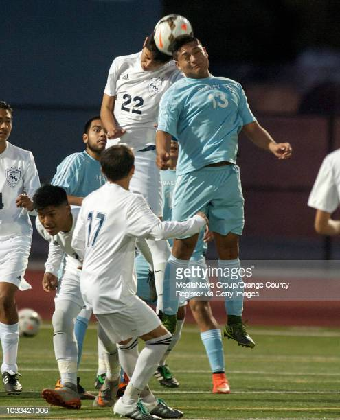 Jafet Lopez top left of Century High School and Marco Salgado of Santa Ana Valley battle for the ball in a game Friday Jan 15 at Century High School...