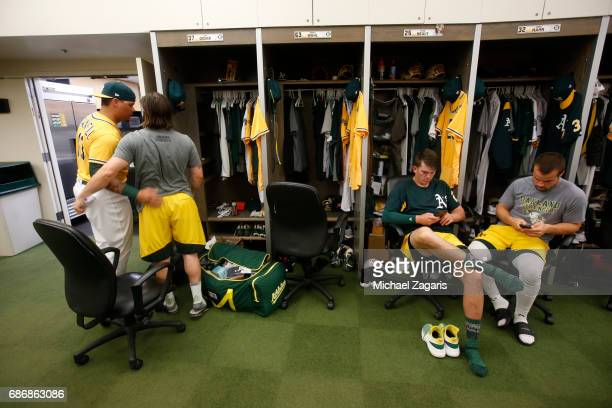 Jaff Decker of the Oakland Athletics says goodbye to Bruce Maxwell in the clubhouse after being sent down prior to the game against the Los Angeles...