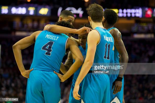 Jagan Mosely Trey Mourning James Akinjo Greg Malinowski Josh LeBlanc of the Georgetown Hoyas huddle against the Villanova Wildcats at the Wells Fargo...