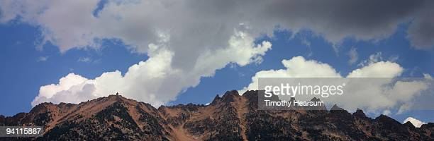 jagged mountain peaks with clouds - timothy hearsum stockfoto's en -beelden