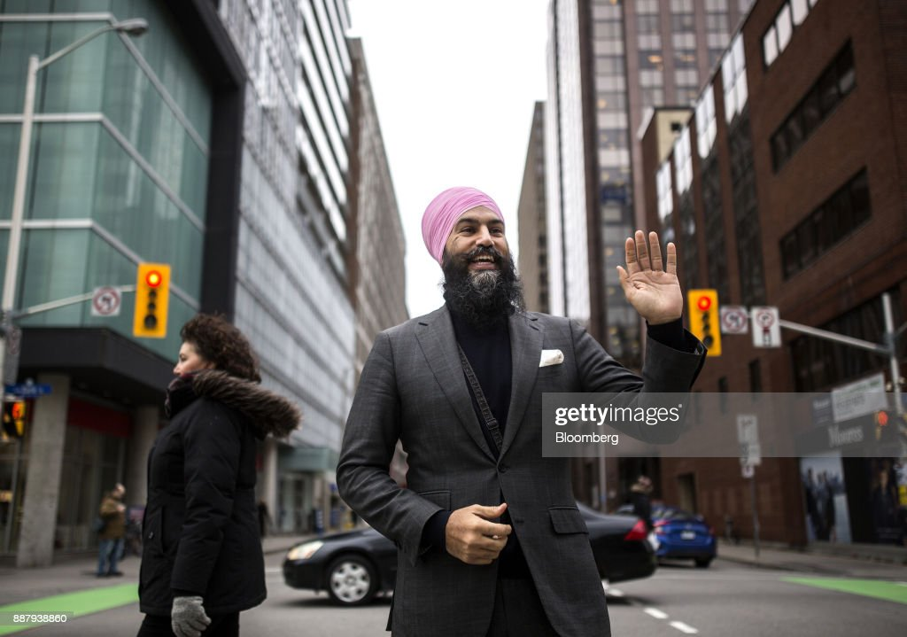 Jagmeet Singh, leader of the New Democratic Party (NDP), waves to a pedestrian while standing for a photograph in Ottawa, Ontario, Canada, on Thursday, Dec. 7, 2017. Singh was elected as the leader of the New Democratic Party on October 1. Photographer: Chris Roussakis/Bloomberg via Getty Images