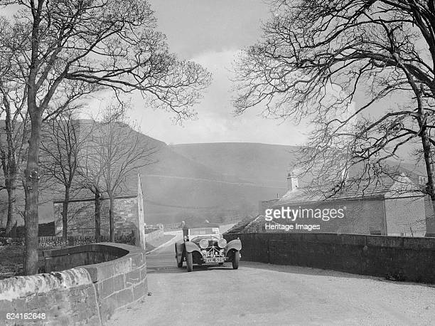 Jaguar 100 of Mrs IW McLennan competing in the RAC Rally, 1939. Artist: Bill Brunell.SS Jaguar 100 1937 20 hp Vehicle Reg. No. EUL525. Event Entry...