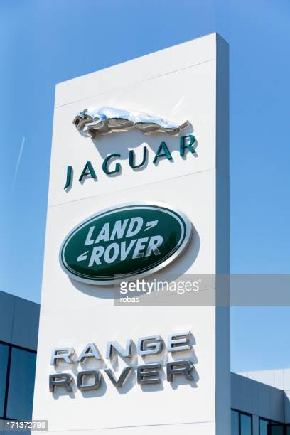 jaguar and land rover cars sign outdoors, - jaguar stock photos and pictures