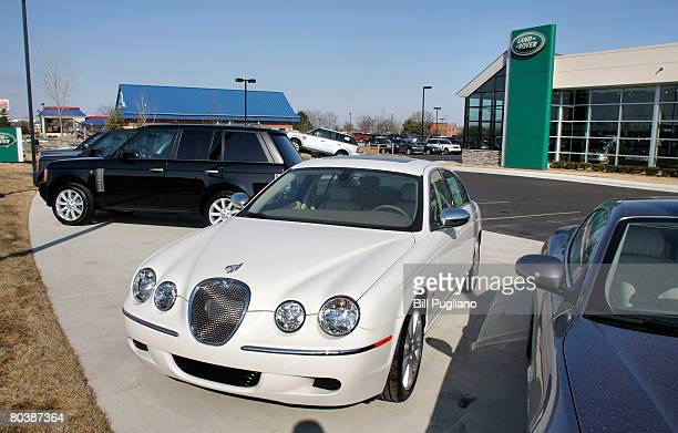 Jaguar and Land Rover vehicles sit for sale at a Jaguar/Land Rover dealership March 26 2008 in Utica Michigan Ford Motor Company announced it had...