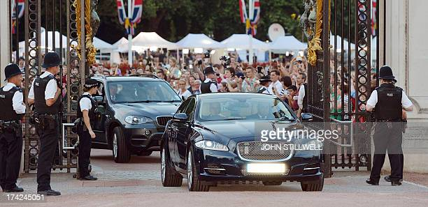 A Jaguar car is driven on July 22 2013 into the forecourt of Buckingham Palace bringing the news to announce the birth of a baby boy at 424pm to...