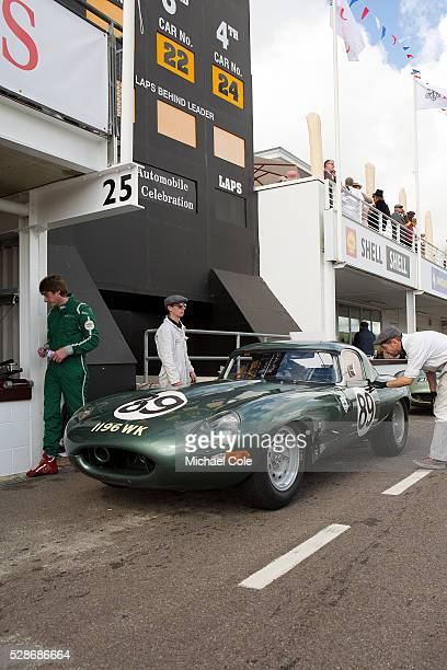 Jaguar Etype in pit lane during the RAC TT Celebration race Entrant Derek Hood drivers Gordon Shedden/Chris Ward