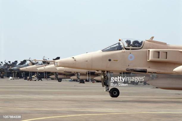 Jaguar fighter aircraft, painted in pink camouflage, prepare to depart their base at RAF Coltishall for deployment in the first Gulf War . The...