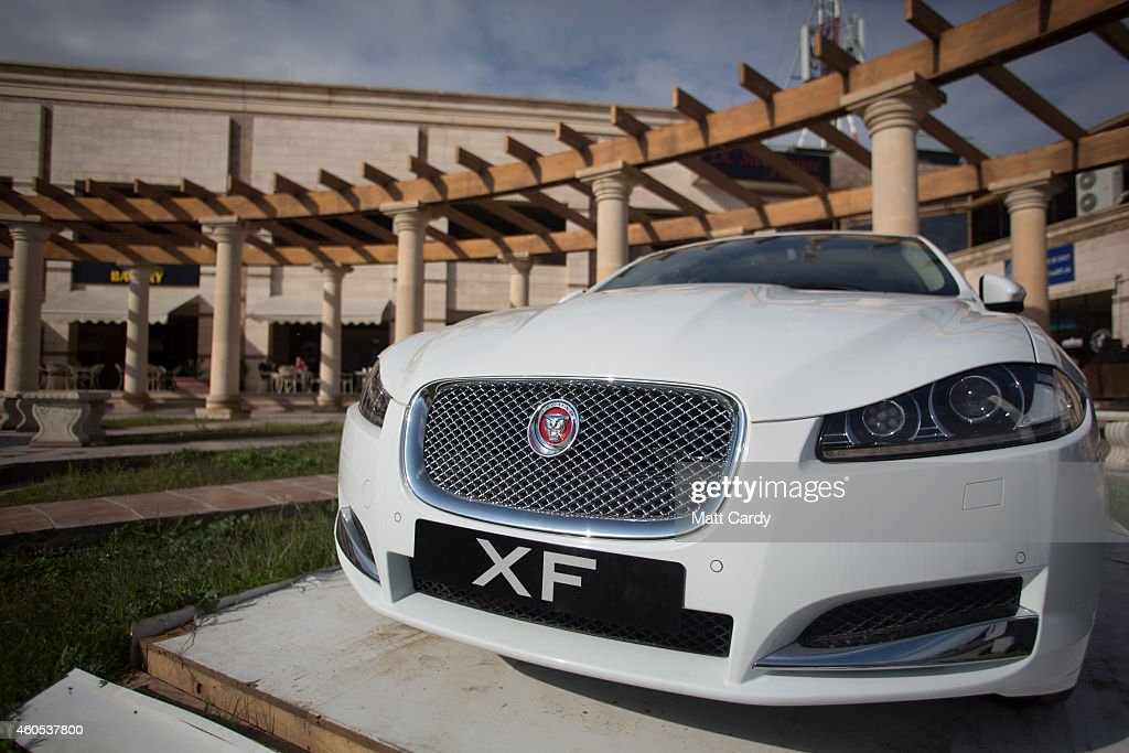 A Jaguar is displayed for sale outside a restaurant complex at Dream City, a new exclusive residential suburb that is being developed in Erbil on December 15, 2014 in Erbil, Iraq. Dream City, is one of several high value residential areas that have been built in the Kurdistan capital since 2003 and are complete with their own mosque, shopping areas and schools. Property values vary, but many villas in the gated and walled development are now valued at over $1million and it even features a $20million US White House replica. Despite insecurity in the rest of Iraq, the semi autonomous region of Kurdistan has been seen by some investors as the new Dubai and although the advance of Islamic State and a budget row with Baghdad has dampened some of the enthusiasm, the city skyline is still changing at a rapid pace.