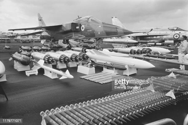 Jaguar joint British-French jet attack aircraft of the Royal Air Force on display with associated missiles, bombs and rockets at the 1970 Farnborough...