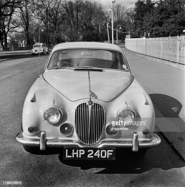 A Jaguar Mark 2 sports saloon car parked on a road in England in April 1968