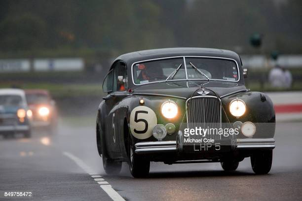 Jaguar Mk V11 entrant Derek Hood driven by Nicholas Minassian in the St Mary's Trophy at Goodwood on September 8th 2017 in Chichester England