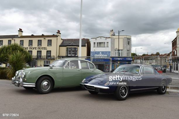 Jaguar Mk2 24 and a Lotus Elan 2 on display during the Southend Classic Car Show along the seafront on June 17 2018 in Southend on Sea England