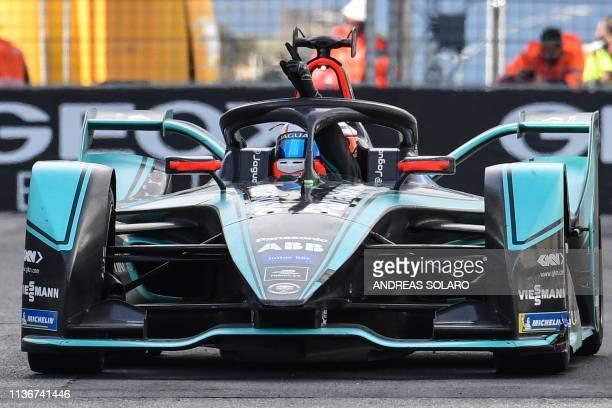 Jaguar Racing's New Zealand driver Mitch Evans celebrates after winning the Rome EPrix leg of the Formula E season 20182019 electric car championship...