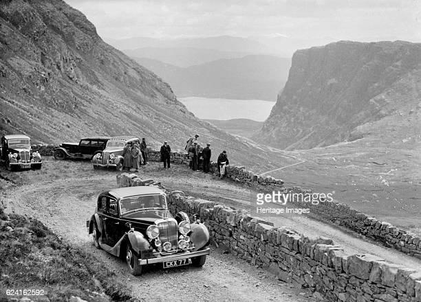 SS Jaguar saloon of DS Hand competing in the RSAC Scottish Rally 1936 Artist Bill BrunellSS Jaguar Saloon 1936 2663 cc Vehicle Reg No CKX77 Event...