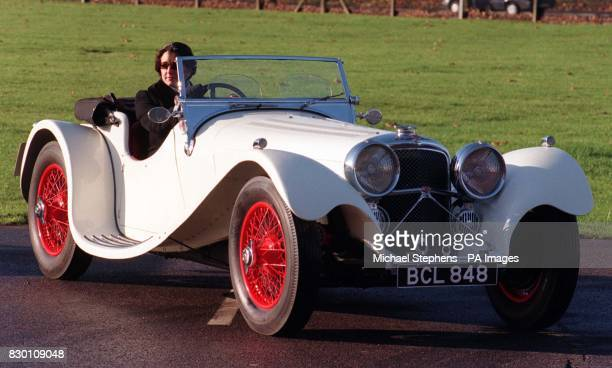 Jaguar SS100 2.5 litre two-seater sports. Helen Griffith of Sotheby's sits a 1939 Jaguar SS100 2.5 litre two-seater sports at RAF Hendon, today . The...