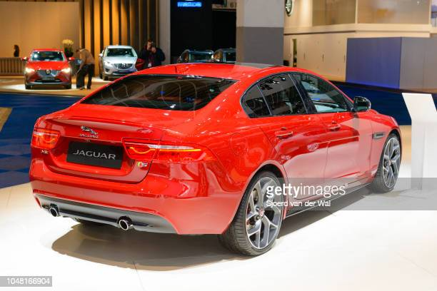 Jaguar XE-series British compact luxury sedan car rear view on display at Brussels Expo on January 13, 2017 in Brussels, Belgium. The Jaguar XE is...