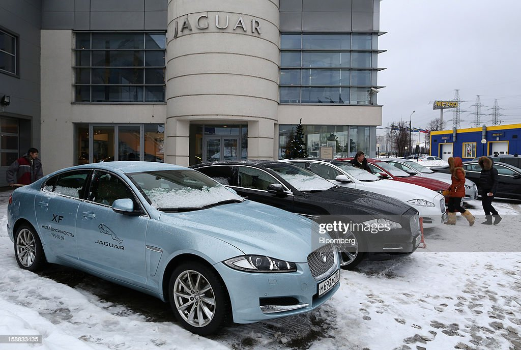 Jaguar XJ series automobiles stand on the forecourt of an independent auto showroom for customers to test in Moscow, Russia, on Friday, Dec. 28, 2012. Tata Motors Ltd.'s Jaguar Land Rover luxury unit signed a letter of intent with Saudi Arabia's government to study the feasibility of setting up a factory to build its models locally. Photographer: Andrey Rudakov/Bloomberg via Getty Images
