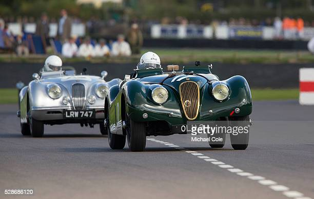 Jaguar XK 120 driven by Nick Finburgh leading another Jaguar XK 120 in the Fordwater Trophy race