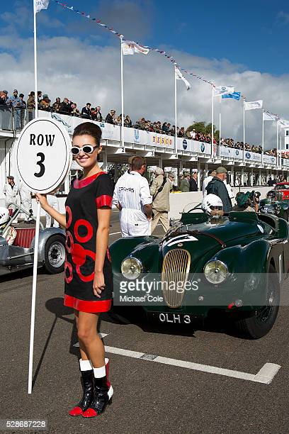 Jaguar XK 120 driven by Nick Finburgh on the start line with Grid Girl at start of Fordwater Trophy race