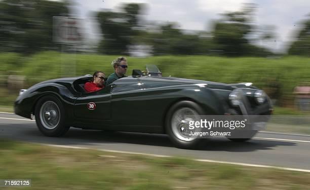 Jaguar XK 120 Lightweight drives near Dyck Castle August 5 2006 in Juechen Germany The car built in 1950 is part of 'Schloss Dyck Classic Days' a...