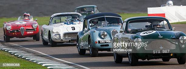 Jaguar XK140 Lightweight coupe leading 1960 Chevrolet Corvette Fordwater Trophy race at The Goodwood Revival Meeting 15th Sept 2013