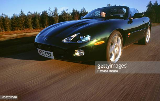 Jaguar XKR driving on country road 2000