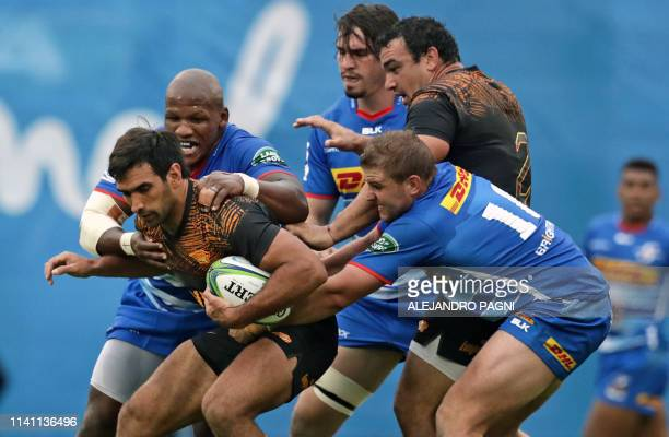 Jaguares centre Matias Orlando vies for the ball with South Africa's Stormers hooker Bongi Mbonambi and fly half JeanLuc du Plessis during their...