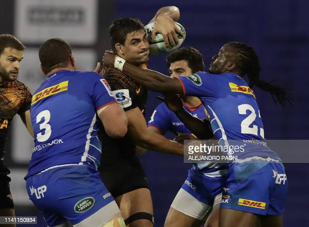 Jaguares flanker Pablo Matera vies for the ball with South Africa's Stormers prop Wilco Louw and fullback Seabelo Senatla during their Super Rugby...