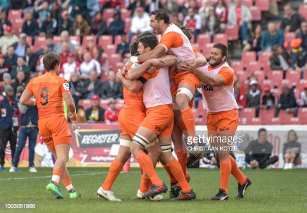 Jaguares' Pablo Matera celebrates with his team mates after scoring his try during the Super Rugby match between the Emirates Lions and the Jaguares...
