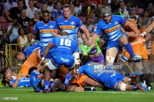 Jaguares' players carry the ball across the try line but knock it on during the Super Rugby rugby union match between South Africa's Stormers and...