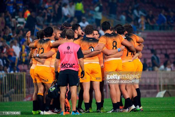 Jaguares' players observe a minute of silence to commemorate the victims of an attack on two mosques in New Zealand before the Super Rugby rugby...