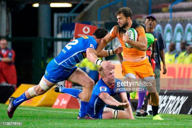 Jaguares' Ramiro Moyano runs with the ball during the Super Rugby rugby union match between South Africa's Stormers and Argentina's Jaguares at...