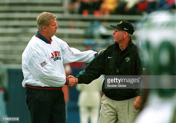 Jaguars coach Tom Coughlin gets a warm handshake from his mentor Patriots coach Bill Parcells following their conversation on the field during...