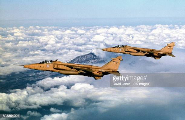 Jaguars from 41 Squadron, based at RAF Coltishall flown by Sqn Ldr Chris Allam and Hauptman Dieter Knorr fly over the smoking crater of Mount Etna on...
