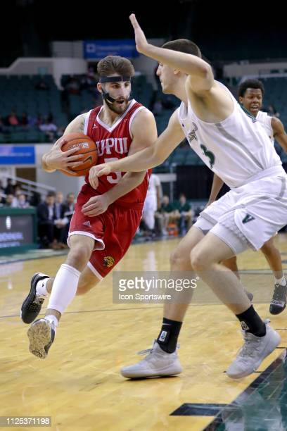 Jaguars guard Camron Justice drives to the basket as Cleveland State Vikings forward Stefan Kenic defends during the second half of the college...
