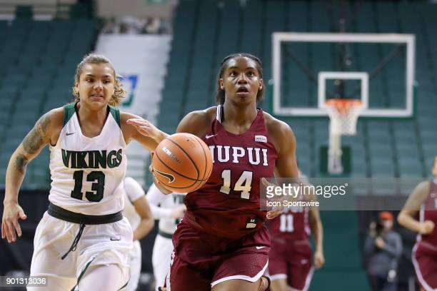 Jaguars guard Danielle Lawrence drives to the basket on a fast break as Cleveland State Vikings guard Mariana Bautista trails on the play during the...
