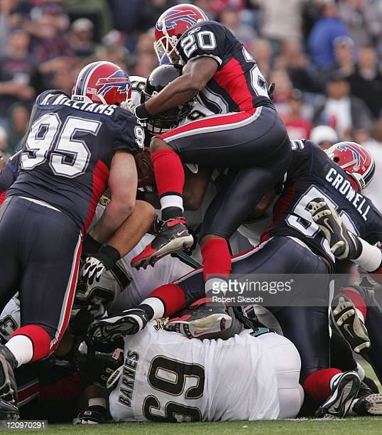 Jaguars quarterback David Garrard gets tackled by Donte Whitner and the defensive line during game between the Buffalo Bills and the Jacksonville...