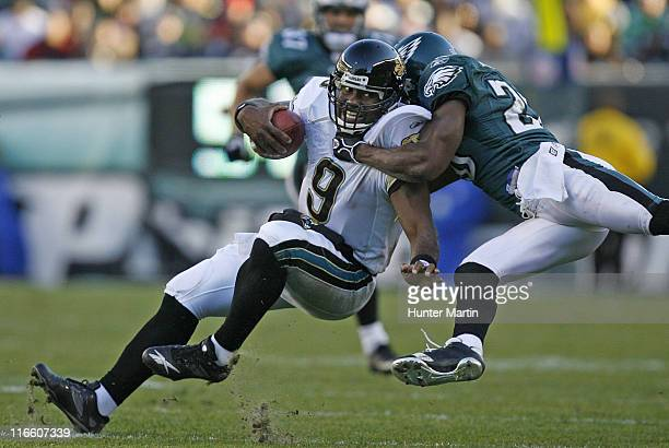 Jaguars quarterback David Garrard is tackled by Eagles safety Brian Dawkins during the game between the Philadelphia Eagles and the Jacksonville...