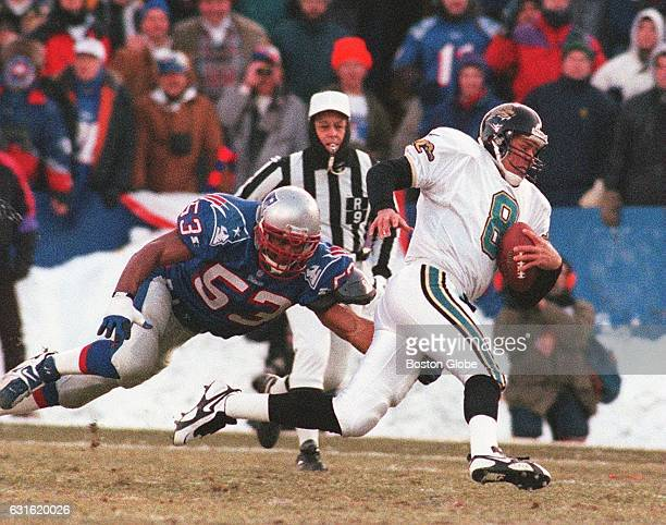 Jaguars' quarterback Mark Brunell is chased by Patriots' #53 Chris Slade New England Patriots face the Jacksonville Jaguars in the AFC Championship...
