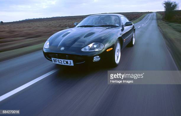 JaguarXKR driving at speed on country road 2000