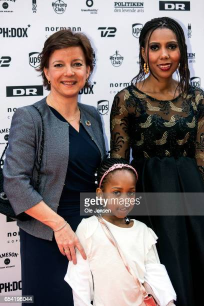 Jaha Dukureh together with Danish Minister for equality Karen Ellemann and Dukureh's daughter pose on the red carpet before the world premiere of the...