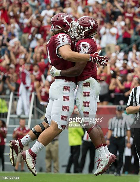 Jahad Thomas of the Temple Owls celebrates with Nick Sharga after scoring a touchdown in the third quarter against the Charlotte 49ers at Lincoln...